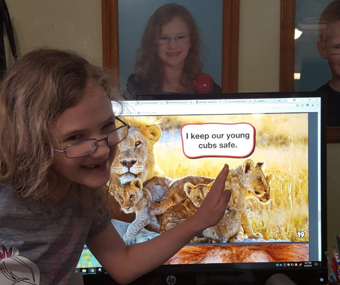 Weigl Publishers Lions eBook young girl in glasses wants to pet the cubs