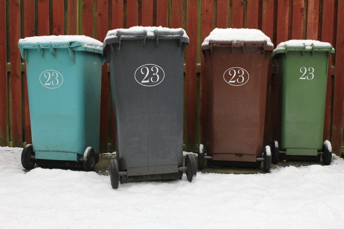 10 Terrific Hacks That Will Transform Your Home into a Paradise image trash and recycle bins near fence covered in snow