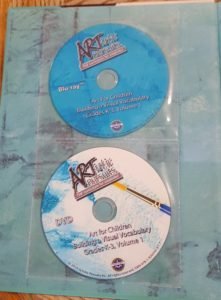 Product Review of ARTistic Pursuits image inside cover of book with the two DVDs