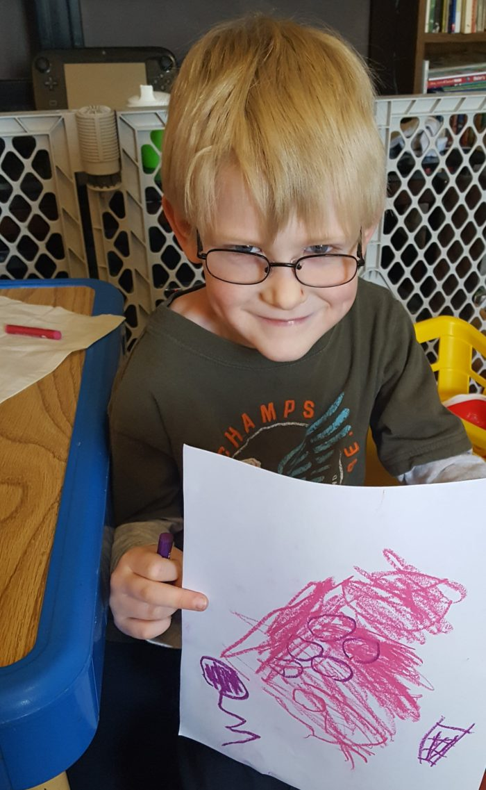 Product Review of ARTistic Pursuits image boy in glasses holding his work of art