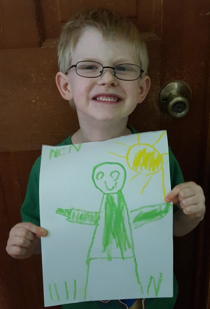 Product Review of ARTistic Pursuits image boy holding picture he drew of a figure and sun