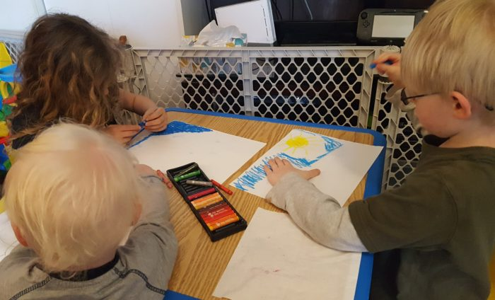 Product Review of ARTistic Pursuits image three small children doing an art lesson with oil pastels and paper