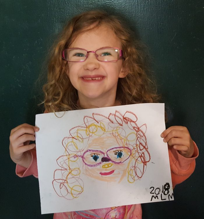 Product Review of ARTistic Pursuits image girl in glasses holding up her self portrait she made