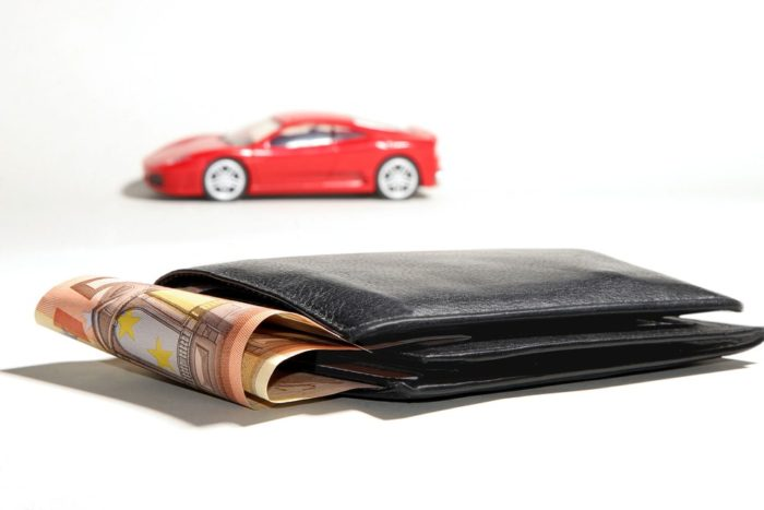 Buying a car image matchbox car wallet with money