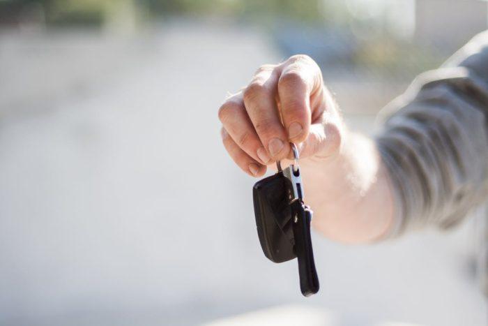 Buying a car - image hand holding car keys