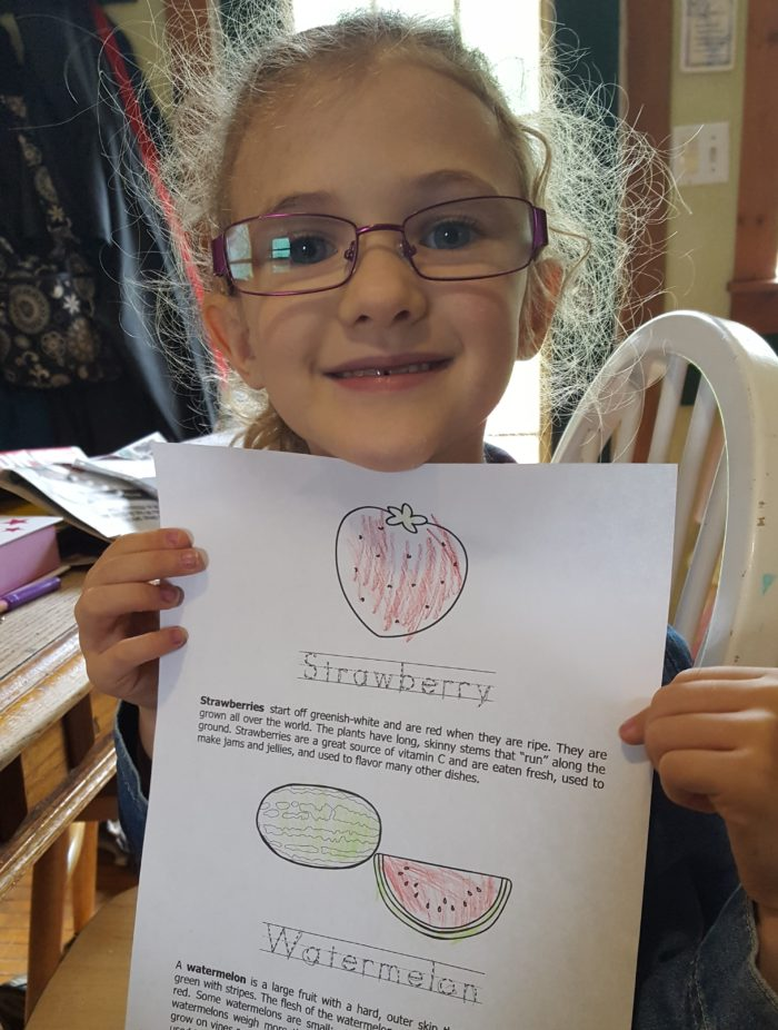 Review of WriteBonnieRose Science girl wearing glasses holding worksheet of strawberry and watermelon