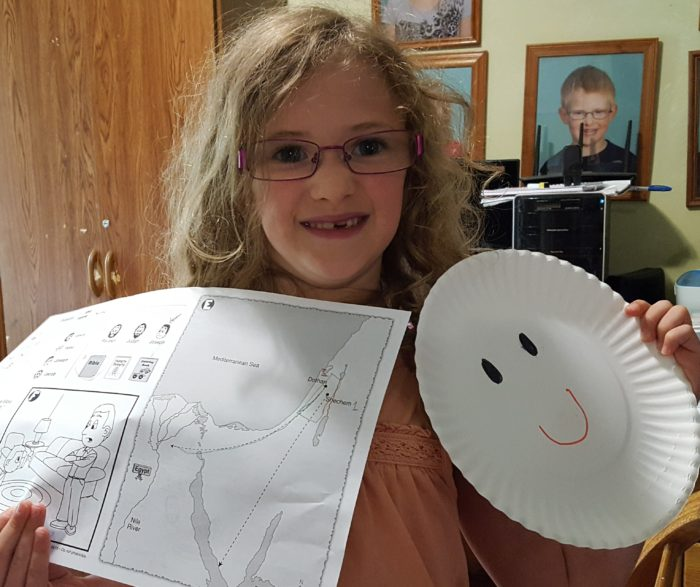 Bible Study Guide For All Ages Review 2nd grade girl holding her page and project