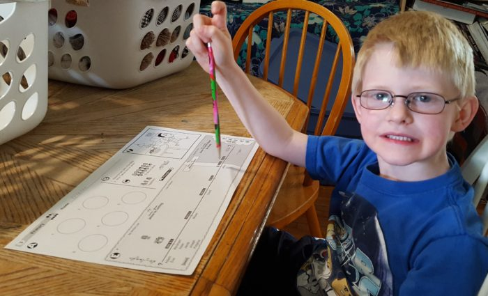 Bible Study Guide For All Ages Review boy doing a Bible page