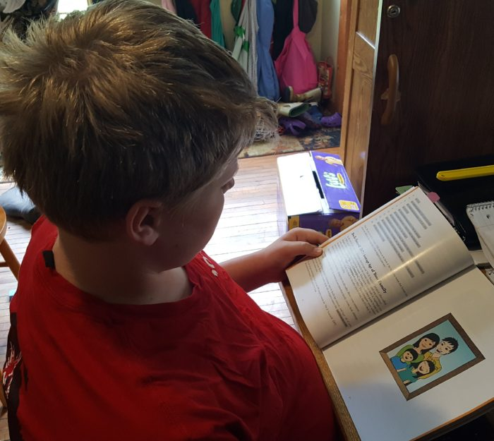 Code for teens - a teenager reads a computer programming book