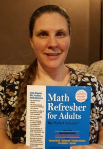 Math refresher for adults review image of Amy Marohl holding Math workbook