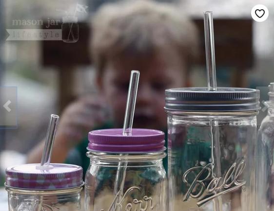 Reusable glass straws in mason jars kerr jar ball jar with boy looking on mason jar lifestyle