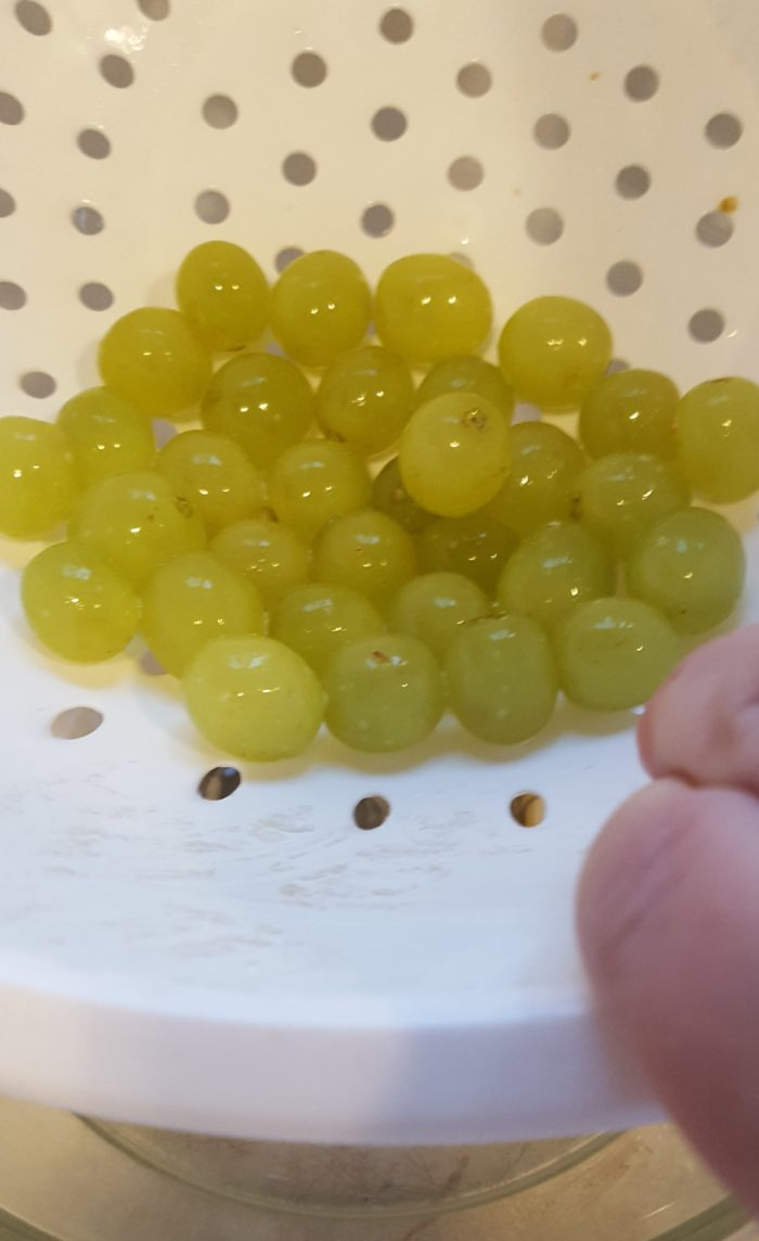 Young Living Thieves Products grapes in a strainer before rinsing