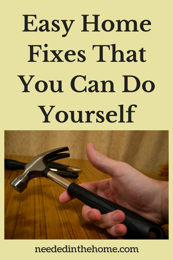 Easy Home Fixes That You Can Do Yourself hand holding a hammer neededinthehome