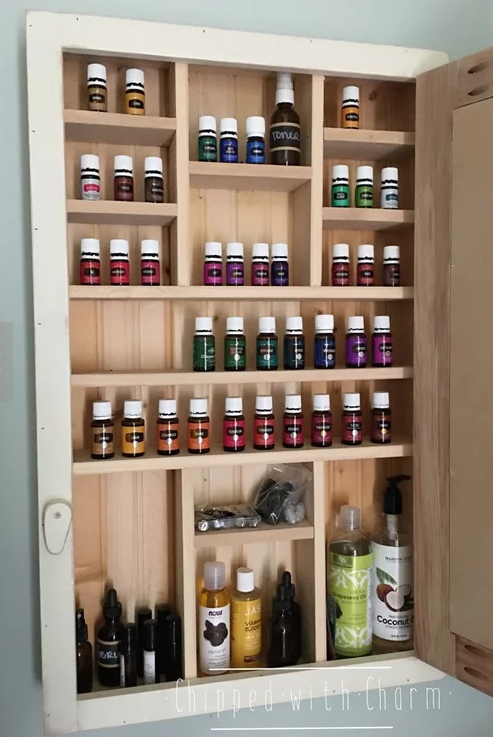 Unique home decor chalkboard cabinet inside shelves with essential oils chipped with charm