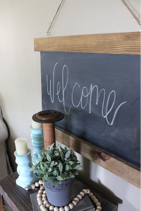 Unique home decor chalkboard front entryway welcome hanging sign flowers candles
