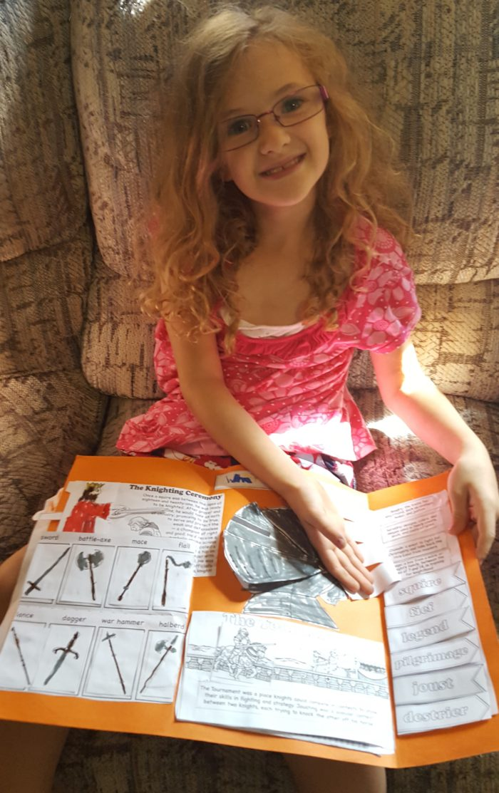Girl with a lap pack on her lap from Homeschool in the woods publishing