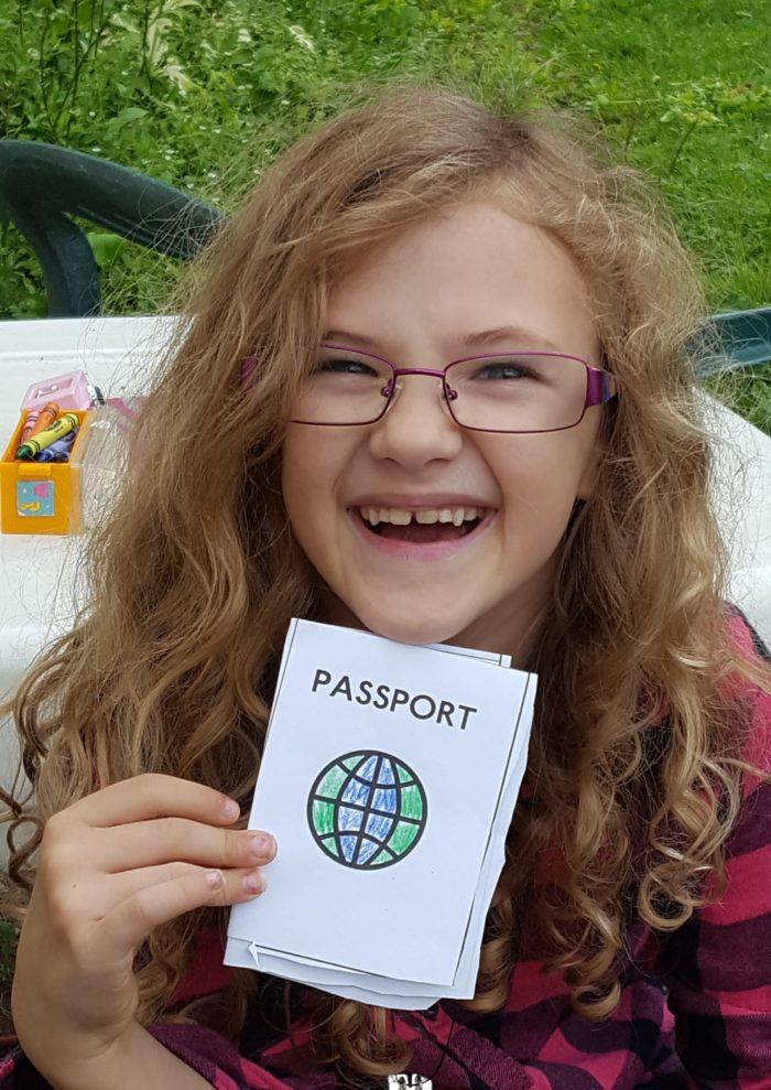 Paddington Bear literature based unit study girl in glasses holding homemade passport