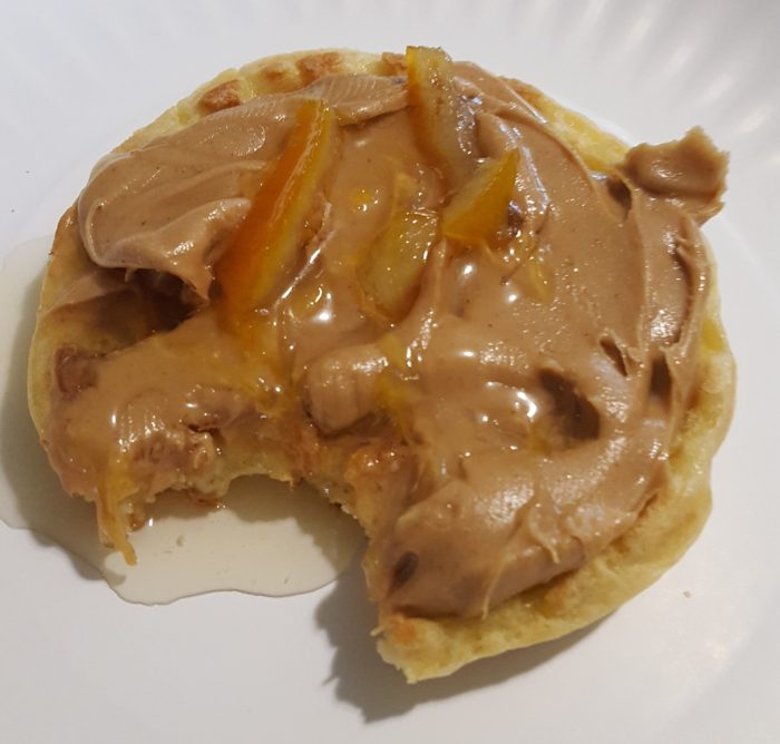 Paddington Bear literature based unit study toaster waffle with peanut butter and marmalade with a bite taken out of it