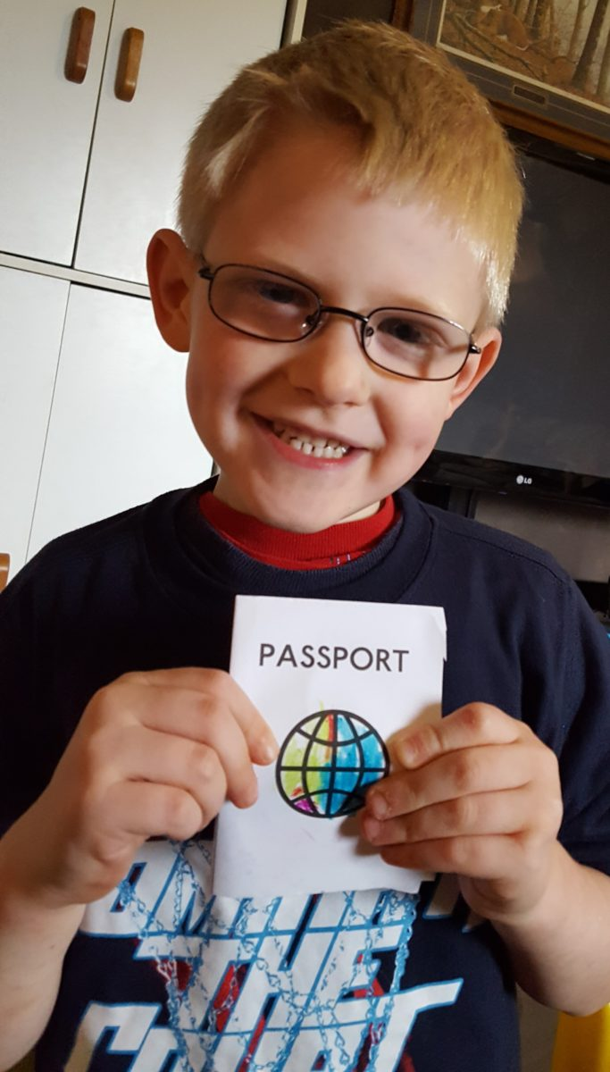 Paddington Bear literature based unit study boy in glasses holding a homemade passport