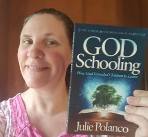 God Schooling book held by a homeschooling mom