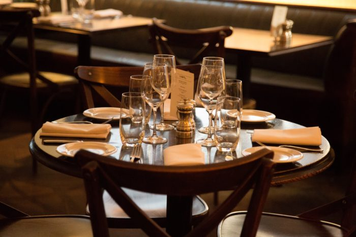 Save money on dining out restaurant table that is set for diners