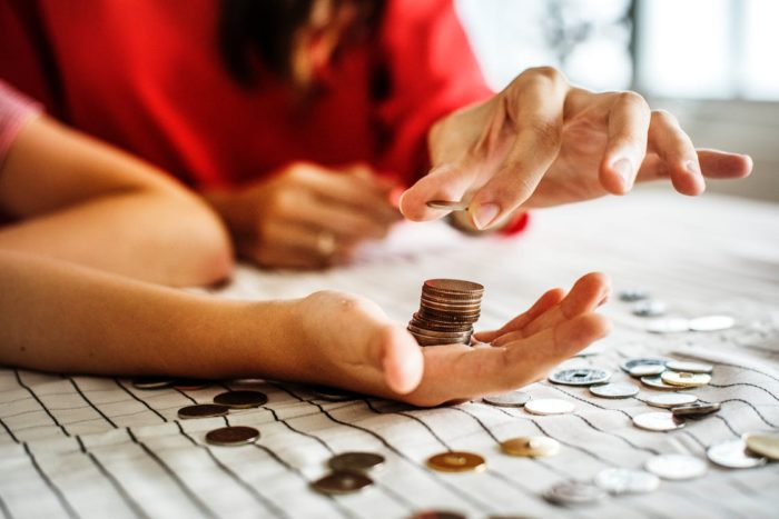 Skills to teach young children - mom and child counting coins money