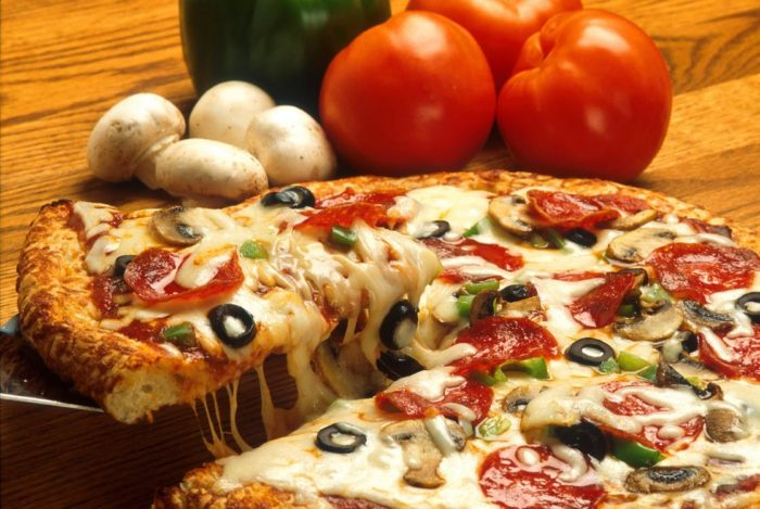 Save Money on Dining Out pizza mushrooms tomatoes