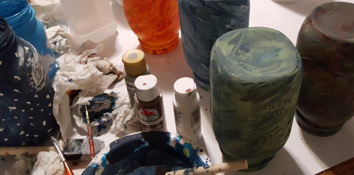 Mason Jar Crafts painted mason jars in fun patterns paints brushes paper towels