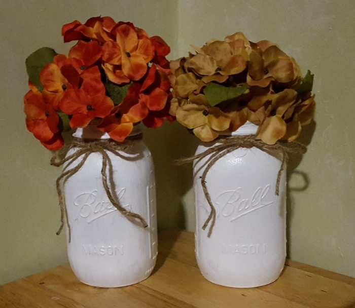 Mason Jar Crafts orange and off-white artificial hydrangea flowers and leaves in white painted ball mason jars with jute twine ties