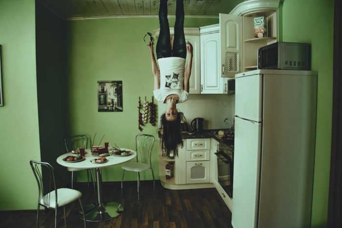 Unused room woman upside down in kitchen