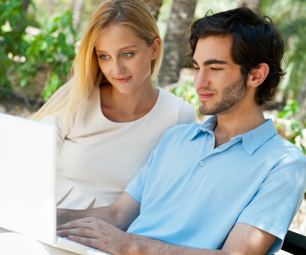 Top home-buying mistakes couple looking online using a laptop to find a home to purchase