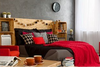 Boost the comfort of your bedroom - bed with pillows sheets comforter table tea or coffee books headboard clock