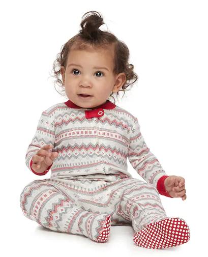 Baby girl in Christmas pajamas