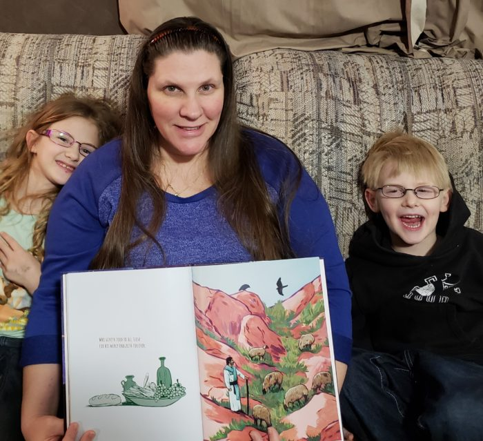 Psalm 136 book review Mom shows the illustrations in Christian picture book with young daughter and son near her