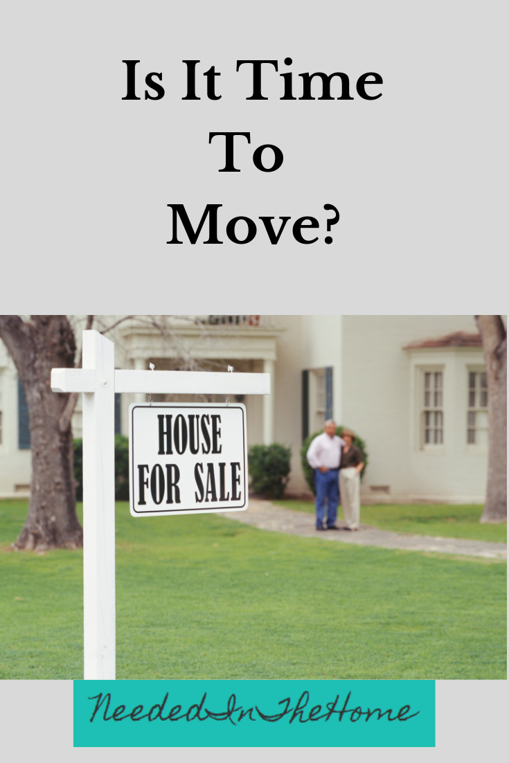 Is it time to move? couple standing in front of their house for sale neededinthehome