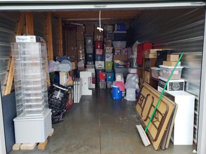 Best way to pack a storage unit odd shaped items along walls with boxes in back