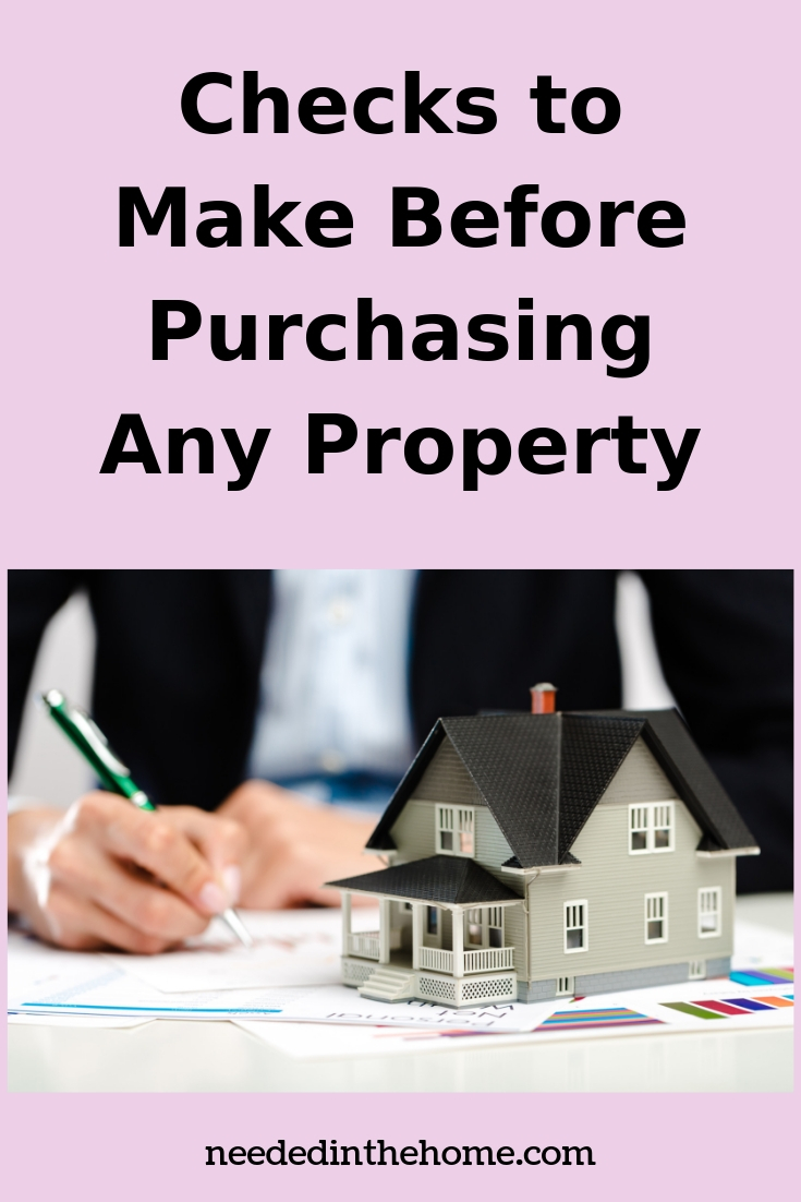 Checks to make before purchasing any property man writing a check near home model sitting on graphs neededinthehome