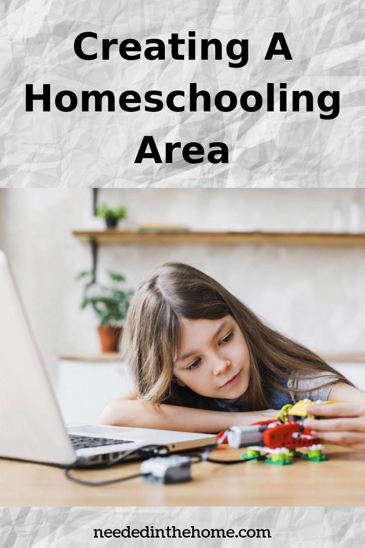 Creating a homeschooling area girl robotics toys laptop doing homeschool at table neededinthehome