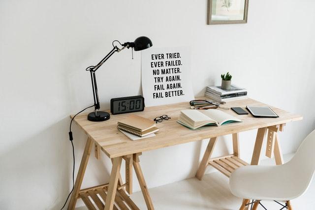 Creating a homeschooling room wood desk lamp clock sign books glasses chair
