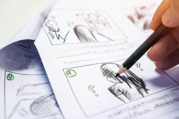 Stories finding inspiration with a storyboard drawn in colored pencil on white paper