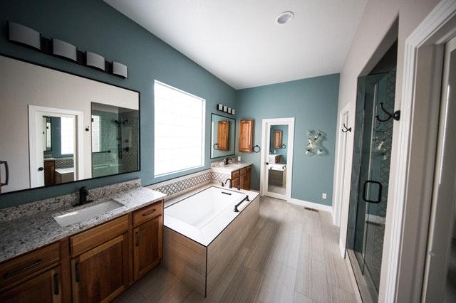 Bathroom design modern bathroom decor aqua paint wood vanity large mirror open tub wood tile floor