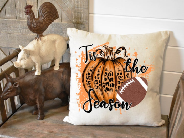 Pumpkin Frost home decor white pillow cover with orange pumpkin Tis the season football next to rooster hog ox decor