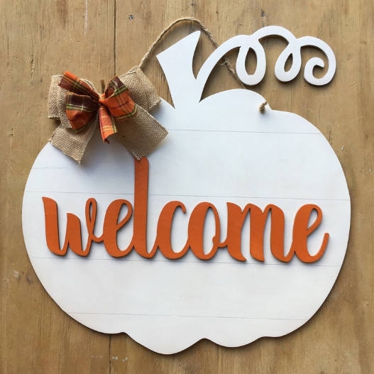 Pumpkin Frost home decor white metal hanging sign with lettering in orange welcome bow