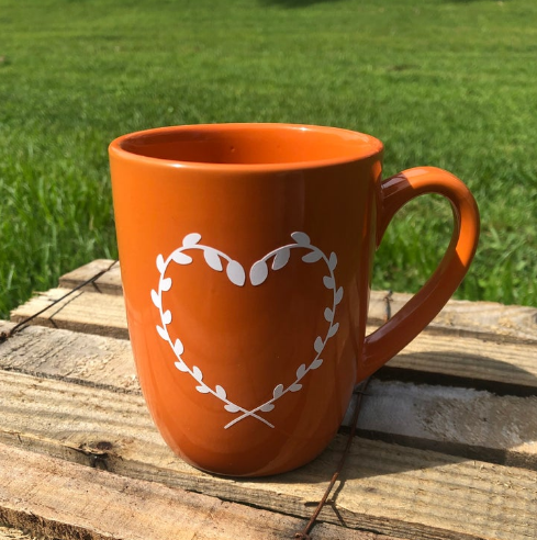 Pumpkin Frost home decor white heart wreath design on pumpkin color coffee mug