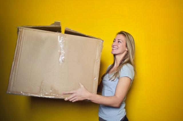 Moving at Christmas woman carrying large box