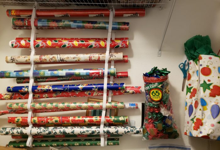 Make a wrapping station homemade roll wrap holder organizer bows scissors gift bag tissue paper