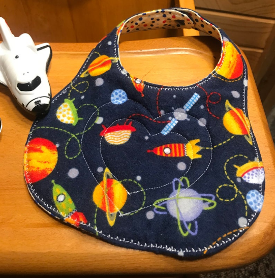 feeding bib with snap close spaceship planets bib design