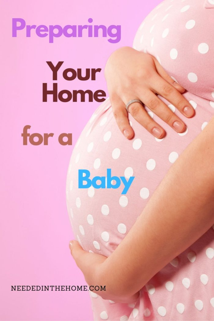 pinterest-pin-description woman holding pregnant belly pink background preparing your home for a baby neededinthehome
