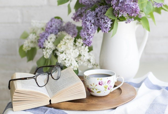 common issues of a home vase of flowers coffee glasses book end table