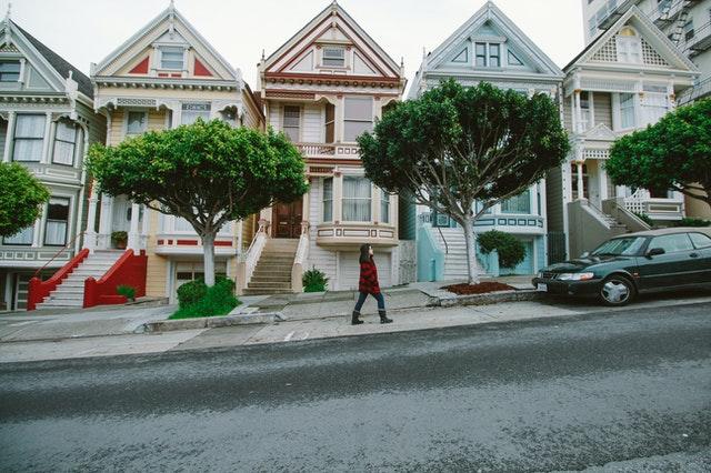moving across country woman walking in neighborhood